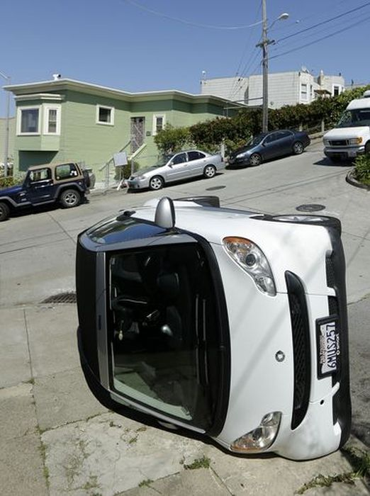 Bad Guys Flipping Over Smart Cars In San Francisco (8 pics)