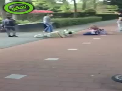 Girl Stops Street Fight With Her Bike