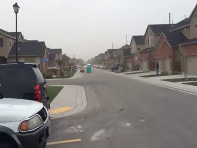 Porta Potty Floats Down The Street With The Wind