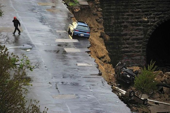 Baltimore Road Collapses And Takes Cars With It (6 pics)
