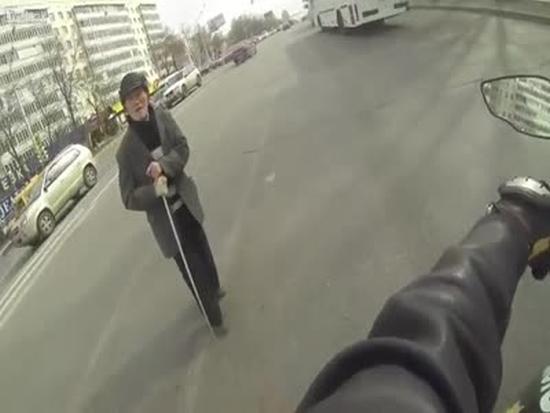 Biker Helps Grandfather Cross the Road