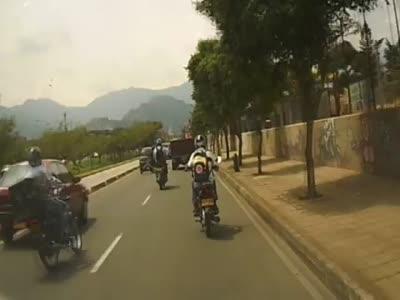 Motorcycle Crashes Into A Car