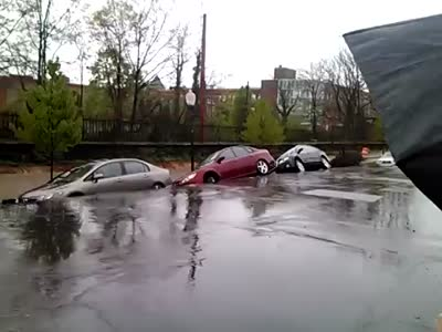 Road Collapses And Destroys Dozens Of Cars