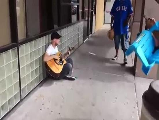 Street Musician Receives Replenishment
