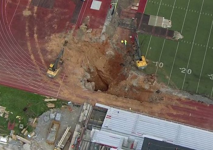 This Sinkhole Ate The End Zone (7 pics)