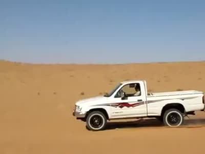 Climbing The Sand Dune With A Truck