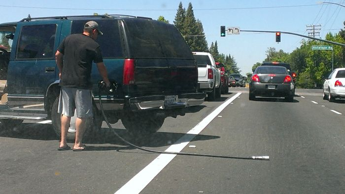 Guy Drives Away With Gas Pump Attached To His Car (8 pics)