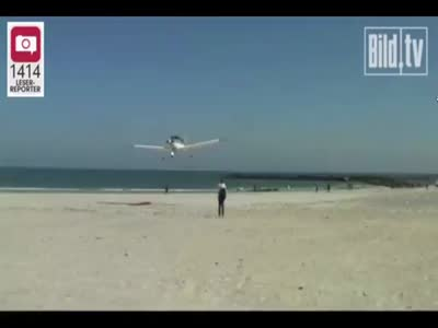 Plane Almost Lands On Sleeping Man At The Beach