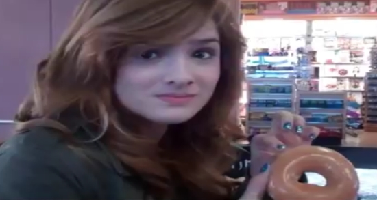 Girl Eating A Donut Like A Lady