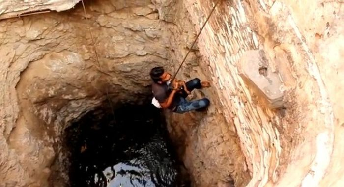 This Brave Man Saved Someone Special From The Well (7 pics)