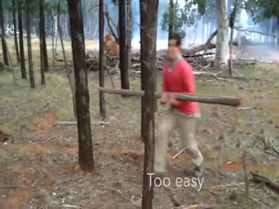 Stupid Guy Splitting Wood For A Bonfire