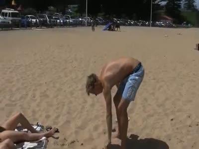 Weird Guy On The Beach Shows A Slug