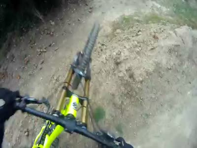 Mountain Biker Hits A Kid On Downhill Track