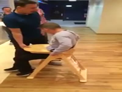 Drunk Guy Stuck In A Baby's High Chair