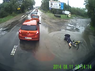 Biker Falls Down Into A Puddle