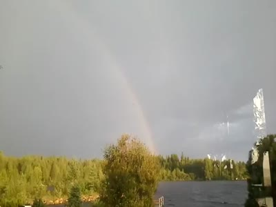 Lightning Almost Hits Man Looking At Rainbow