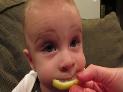 Baby's First Time Tasting a Lemon