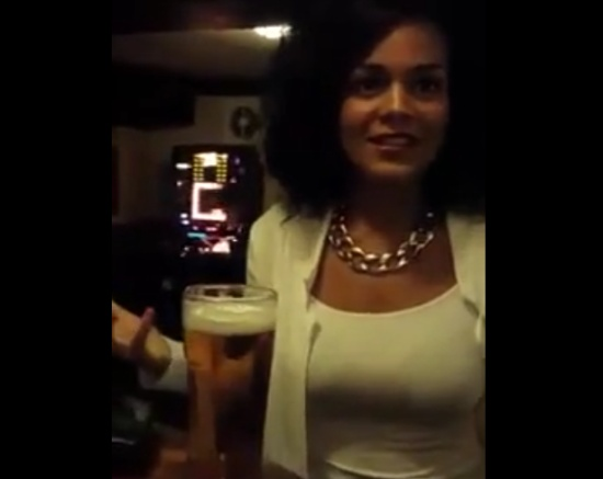 Girl Drinks A Glass Of Beer Without Using Her Hands