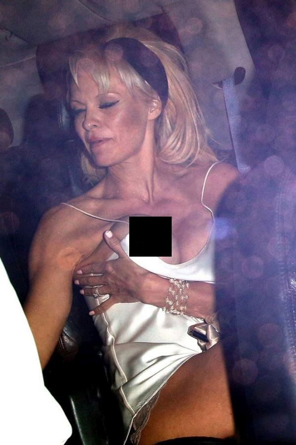 Pamela Anderson Has A Wardrobe Malfunction (12 pics)