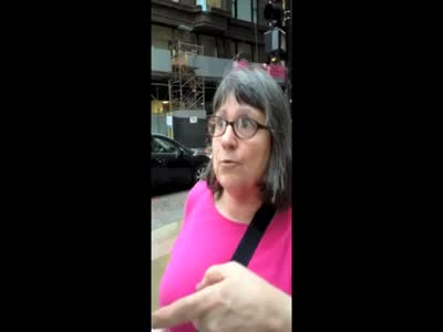 Angry Woman Takes on Cyclist, but Suddenly a Police Officer Appears