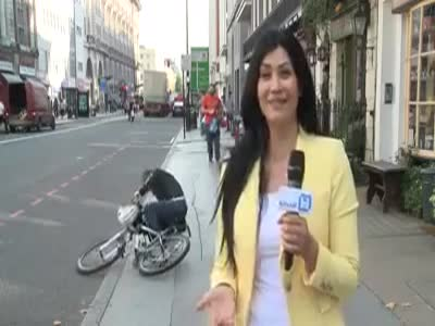 Cyclist Fell off his Bicycle During the News Reporting