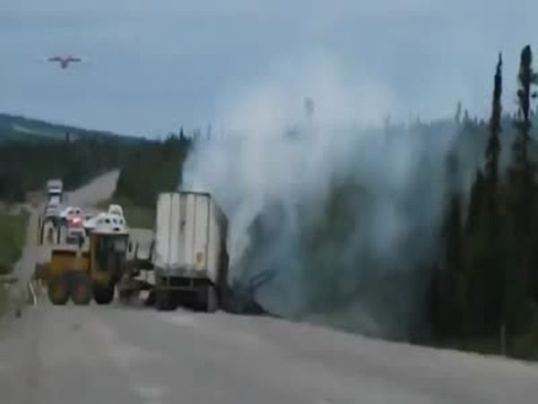 Firefighter Plane Drops Retardant on on a Truck