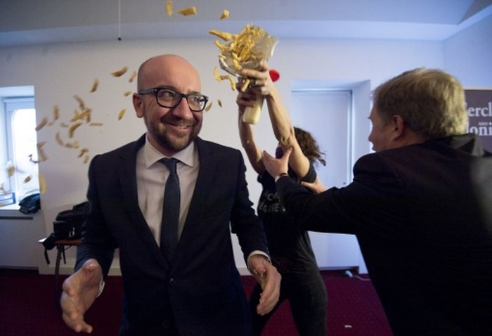 Protesters Cover The Belgian Prime Minister In Chips And Mayo (6 pics)