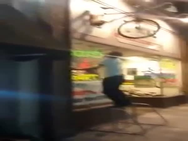 Drunk Guy Attempts To Climb On Bike And Falls Down