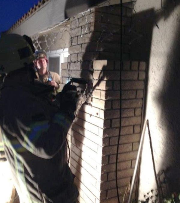 Mother Of Three Tries To Break Into Home Through Chimney (3 pics)