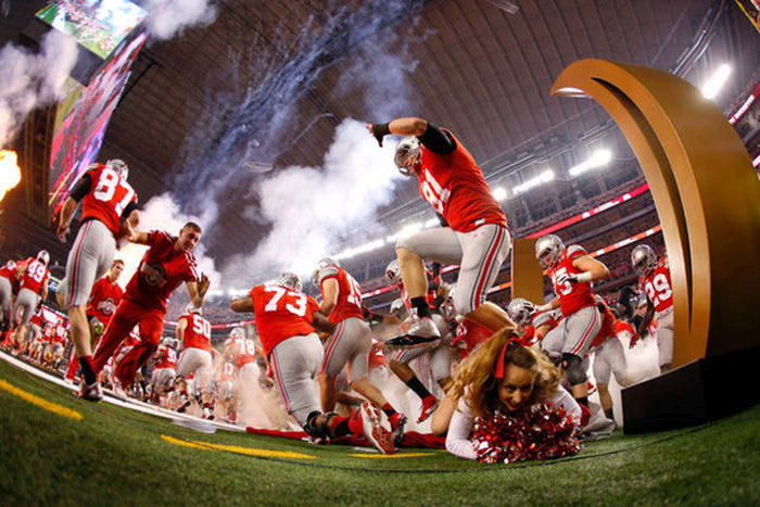 This Cheerleader Almost Got Trampled By The Ohio State Football Team (4 pics)