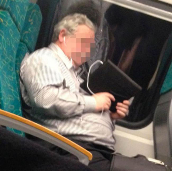 No One Noticed What This Guy Was Watching On The Train (2 pics)