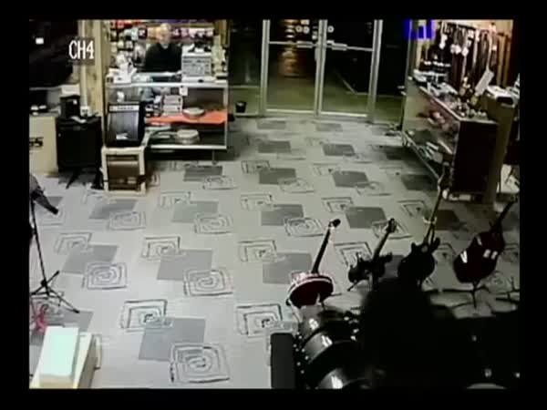 Robber Plays Dead When Store Owner Points A Gun To His Head