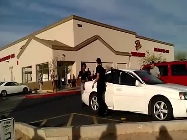 Guy Hangs On To A Moving Car