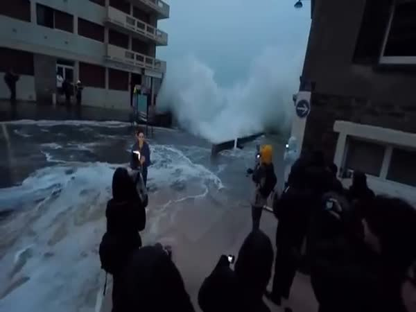 TV Reporter Gets Surprised By A Big Wave
