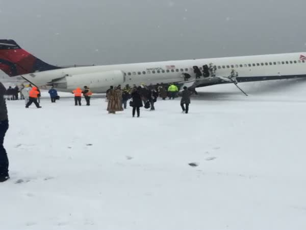 Plane Skids Off Snowy Runway At New York's LaGuardia Airport