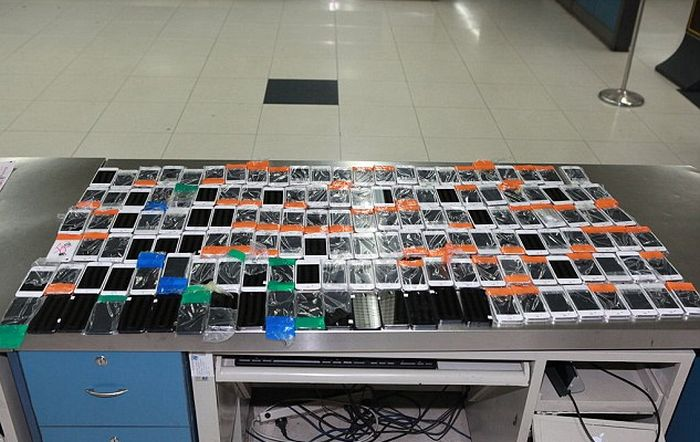 Smuggler Gets Busted With 146 iPhones Taped To His Body (3 pics)