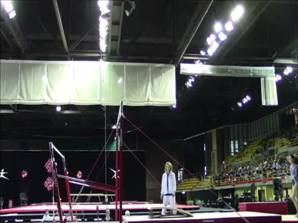 Coach Catches A Falling Gymnast Twice