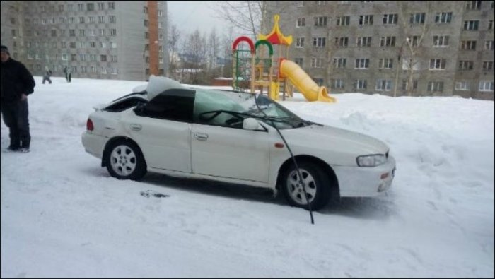 A Giant Block Of Ice Turned This Car Into A Convertible (3 pics)