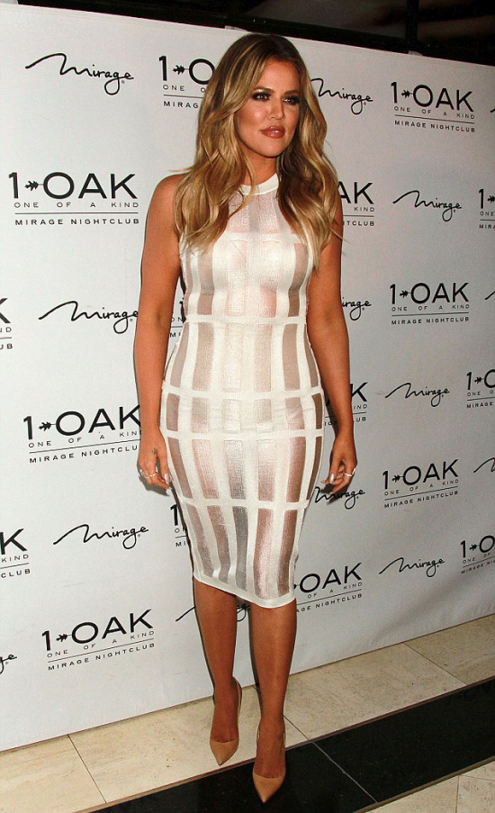 Khloe Kardashian Shows Off Her Body In A Tight White Dress (16 pics)