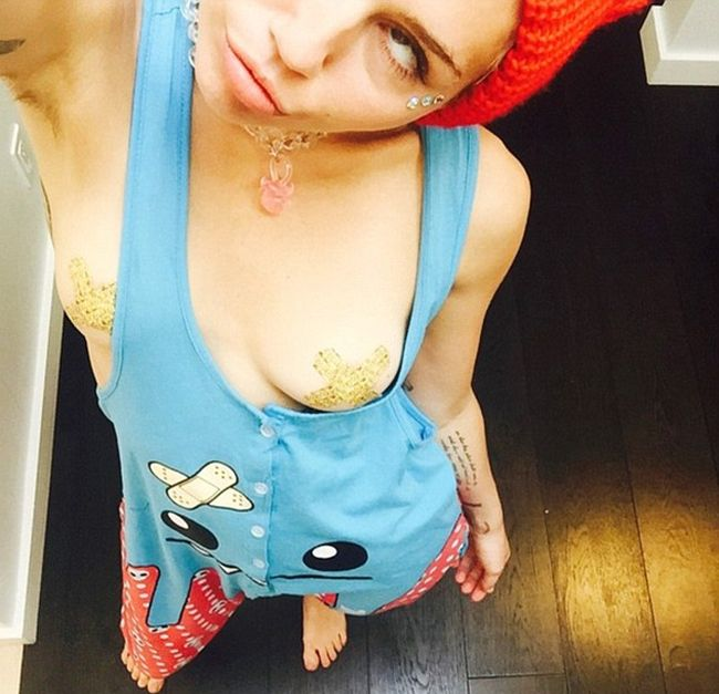 Miley Cyrus Is Never Shy About Showing Off Her Chest (2 pics)
