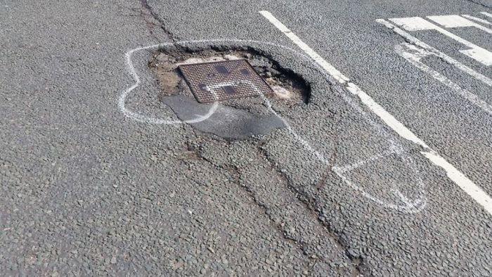 Artist Uses Penises To Draw Attention To Potholes In England (10 pics)