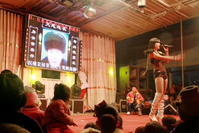 Chinese Authorities Are Cracking Down On Strippers At Funerals (8 pics)