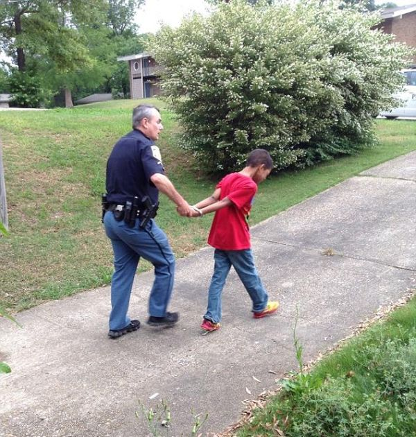 Cops Pretend To Arrest 10 Year Old Boy To Teach Him A Lesson (5 pics)