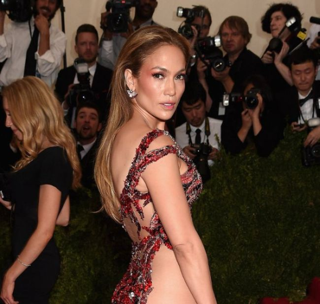 Jennifer Lopez Shows Off Her Beautiful Backside In A See Through Dress (4 pics)