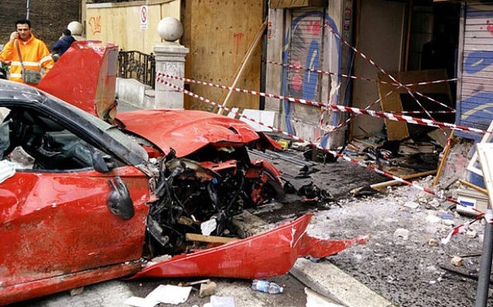 Valet Crashes A Ferrari Right Into A Storefront (4 pics)