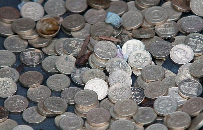 Millions Of Coins Spill On To The Streets Of England (16 pics)