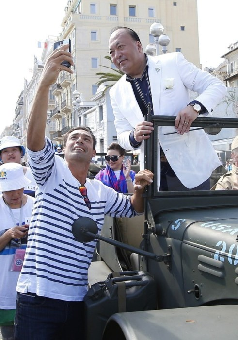 Chinese Businessman Takes 6,400 Workers To France (9 pics)