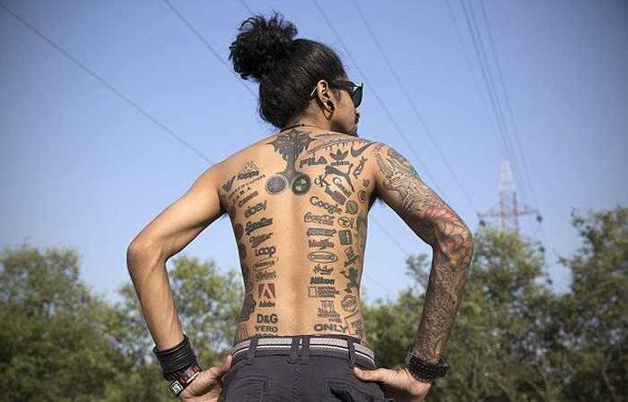 Meet The Man Who Covered His Body With Brand Logo Tattoos (5 pics)