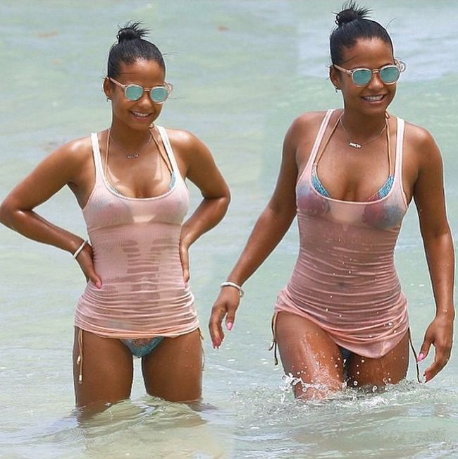 Christina Milian Hangs Out On The Beach In A Soaking Wet Bikini (5 pics)
