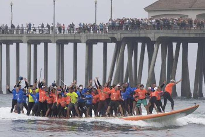 66 Surfers Set A New Guinness Record With A 1,300 Pound Board  (6 pics)